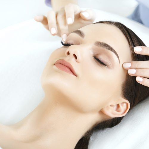 Face Massage. Close-up of a Young Woman Getting Spa Treatment.